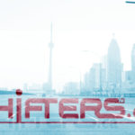 photo of street with CN Tower and Shifters logo